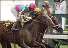 Empire Maker, foreground, couldn't beat Strong Hope in a photofinish of the Jim Dandy Stakes on Sunday at Saratoga.