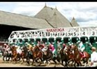 Horses break from the gate in Wednesday's first race on the opening-day card at Saratoga Racecourse.