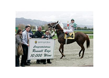 Russell Baze celebrates his 10,000th win, Friday at Golden Gate Fields.