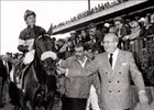 Owner Sam Rubin (right) leads John Henry to one of many winner's circles visited by this most successful pair.