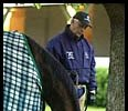 D. Wayne Lukas grazes Proud Citizen at Churchill on April 29, 2002.