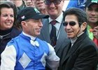 Russell Baze, left, receives congratulations from retired jockey and former record holder Laffit Pincay Jr.