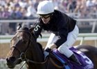 European Horse of the Year Ouija Board crossing the finish line in the VO5 Breeders' Cup Filly & Mare Turf.