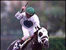 Cat Thief and Pat Day cross the finish line first in the 1999 Breeders' Cup Classic.