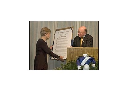 Alice Chandler, left, is presented a scroll by Thoroughbred Club of America historian and director Edward L. Bowen.