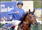 Frankie Dettori celebrates aboard Marienbard after victory in the Prix de L'Arc de Triomphe.