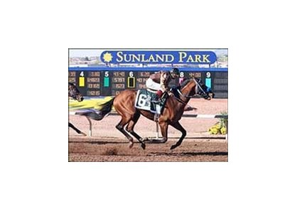 Song of Navarone, with Victor Espinoza aboard, wins the WinStar Derby Sunday at New Mexico's Sunland Park.