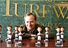 Hall of Famer Steve Cauthen, surrounded by bobblehead dolls in his likeness.