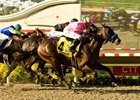 "Richard's Kid, sent off at odds of 24-1, charged from far back with jockey Mike Smith aboard to win the Pacific Classic at Del Mar.<br><a target=""blank"" href=""http://www.bloodhorse.com/horse-racing/photo-store?ref=http%3A%2F%2Fpictopia.com%2Fperl%2Fgal%3Fprovider_id%3D368%26ptp_photo_id%3D8461201%26ref%3Dstory"">Order This Photo</a>"