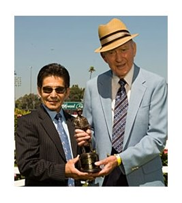 Long-time California steward Pete Pedersen, right, accepts his 2008 Laffit Pincay, Jr. Award.