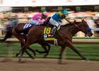 American Pharoah and jockey Victor Espinoza roar past Firing Line.
