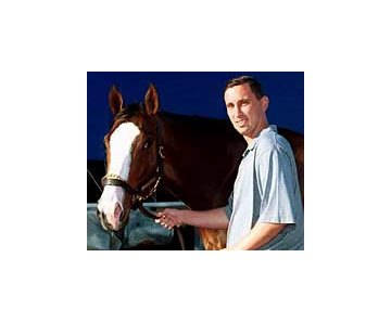 Basketball star and Thoroughbred owner Bobby Hurley with Songandaprayer in  2001.