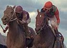 Deputy Commander, right, defeating Behrens in the 1997 Travers Stakes.