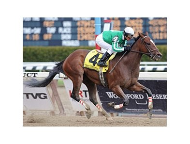 "Capt. Candyman Can pulls away in the Bay Shore.<br><a target=""blank"" href=""http://www.bloodhorse.com/horse-racing/photo-store?ref=http%3A%2F%2Fpictopia.com%2Fperl%2Fgal%3Fprovider_id%3D368%26ptp_photo_id%3D7980334%26ref%3Dstory"">Order This Photo</a>"