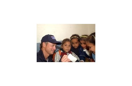 Operation Iraqi Children co-founder Gary Sinise, with Iraqi school children on recent visit.