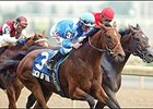 Touch of the Blues, foreground, crosses the finish line to win the Atto Mile Sunday in Toronto.
