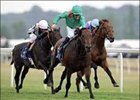 Azamour and jockey Mick Kinane, center, win the King George VI and Queen Elizabeth Diamond Stakes at Newbury.