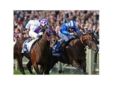 Intense Focus (left) fights for the win in the Darley Dewhurst Stakes.