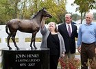 Shelley Hunter admires her finished sculpture of John Henry as KHP Pres. John Nicholson, center, and Bill Oster, founder of the John Henry Memorial Fund, look on.