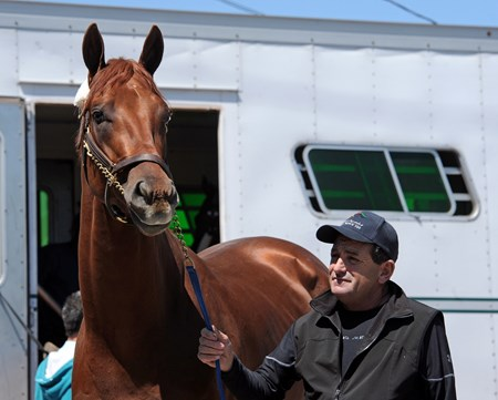 Dortmund, being led off the van by asst. trainer Jim Barnes, arrives at Churchill Downs Sunday afternoon April 26.