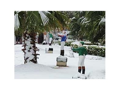 Snow covers the jockey statues along the track apron at Fair Grounds Dec. 11.