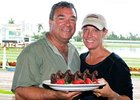 Trainer Joe Orseno celebrates a perfect 5-for-5 day with Michelle Congelosi, DVM at Gulfstream Park April 7.