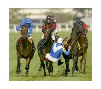 Gary Stevens (4) falls from Storming Home as David Flores aboard Sulamani, far left, and R.R. Douglas aboard Kaieteur, center, try to avoid a collision after crossing the finish line of the Arlington Million.