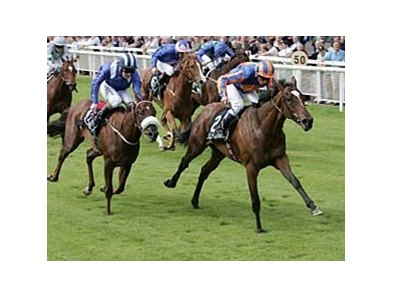 Again (blue and orange silks) holds off Shimah to win the Moyglare Stud Stakes (Ire-I) Aug. 31 at Leopardstown.