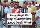 Trainer King Leatherbury (second from right) joins elite few winners of 6,000 races.