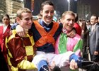 Ryan Moore (left), Christophe Lemaire (middle) and John Murtagh (right), celebrate their success at the presentation ceremony.