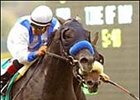 Blackdoun, left, wins the La Jolla Handicap, Saturday at Del Mar.