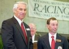 Russell Baze, right, along with trainer D. Wayne Lukas during induction into racing's Hall of Fame.