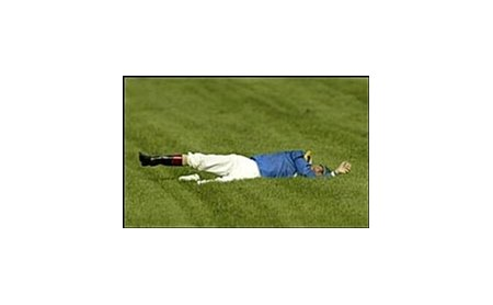 Jockey Gary Stevens lies on ground after Arlington Million accident.