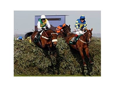 "Eventual winner Ballabriggs (left) clears ""The Chair"" in the Grand National."