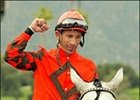 Rene Douglas gestures after he became the 122nd rider in North America to win 3,000 races.