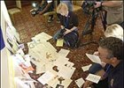 Reporters and photographers study some of the fan mail sent to Smarty Jones on display at Philadelphia Park Racetrack.