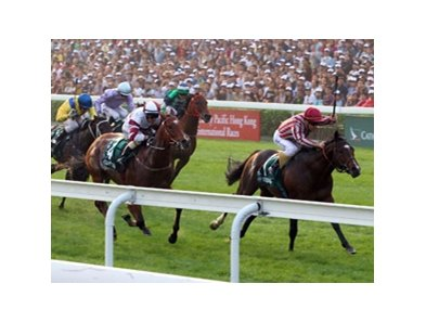 Ridden by Olivier Peslier, Vision D'etat beats a top class field in the Cathay Pacific Hong Kong Cup.