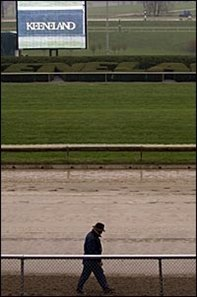 Consignor Kip Elser inspected the condition of the track at Keeneland Monday.
