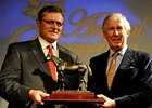 Garrett O'Rourke (L) with Juddmonte Farms accepted the Canadian Horse of the Year statue for homebred Champs Elysees from Michael Byrne of The Jockey Club of Canada.