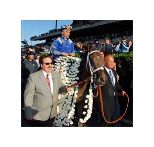 Trainer Kiaran McLaughlin (left), jockey Fernando Jara (aboard) and Shadwell VP/GM Rick Nichols lead Belmont Stakes victor Jazil to the winner's circle.