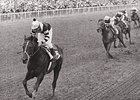 Seattle Slew, draws off in the Belmont Stakes.