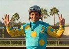 Victor Espinoza celebrates a new Del Mar record seventh trip to the winner's circle.