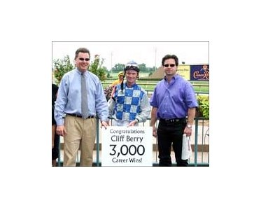 Lone Star Park GM Drew Shubeck (left) and trainer Bret Calhoun (right) flank Cliff Berry after his 3,000th career win.