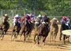 Sir Cherokee, far left, makes his move in the final turn of the Arkansas Derby, Saturday at Oaklawn Park.