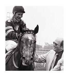 "Trainer Grover ""Buddy"" Delp (right) with Spectacular Bid."