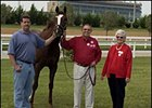 Morning line John Deere Turf favorite Kitten's Joy, with trainer Dale Romans (left) and owners Ken and Sarah Ramsey.