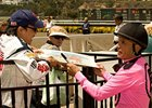 Patrick Valenzuela signs an autograph at Del Mar on July 28.