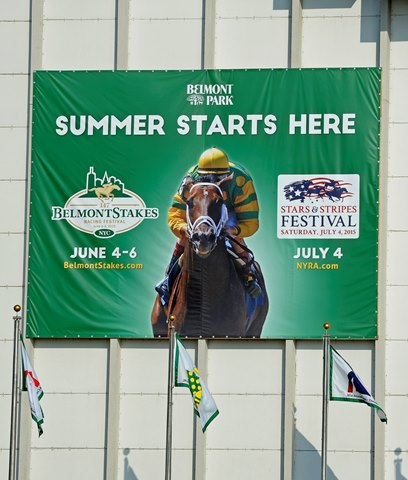 Caption:  sign and flags outside clubhouse