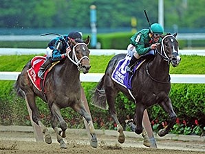 Cocked And Loaded wins the 2015 Tremont Stakes.