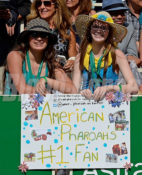 Caption:  American Pharoah fans and sign